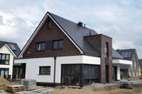 Modernes massivhaus einfamilienhaus meerbusch ratingen mit sateldach schl sselfertiges bauen - Fenster turen bauelemente busch duisburg ...